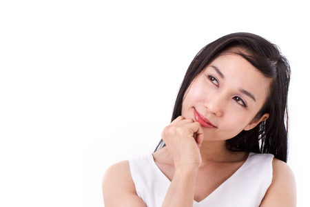 women face stare: happy woman looking up at blank space Stock Photo