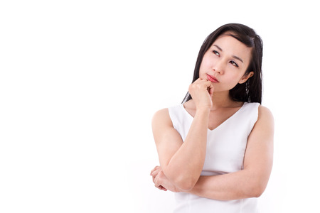 skeptical: unhappy, worried, skeptical woman looking up Stock Photo