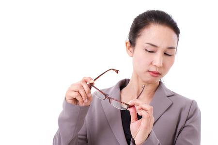 poor eyesight: businesswoman suffers from poor eyesight Stock Photo