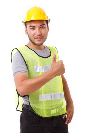 thumbup: construction worker showing thumb up gesture on white background