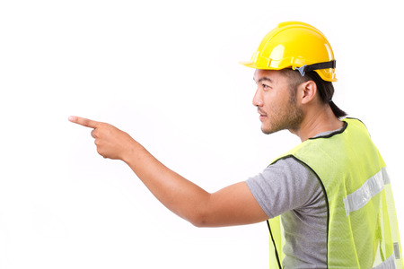 sideway: construction worker pointing sideway to blank space