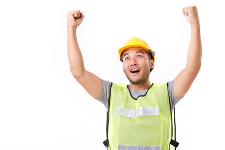 exalted: happy, successful construction worker on white background