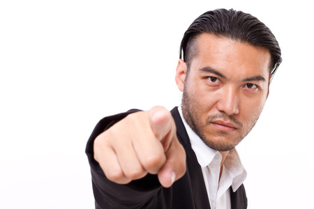 serious businessman: serious businessman pointing at you Stock Photo