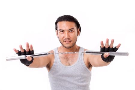 nunchaku: asian Kung Fu man with chainsticks or nunchaku