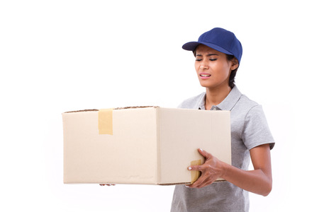 delivery box: female delivery staff carrying heavy parcel carton box