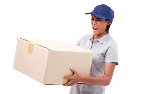 back to work: female delivery staff carrying heavy parcel carton box