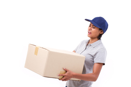 female delivery staff carrying heavy parcel carton box photo