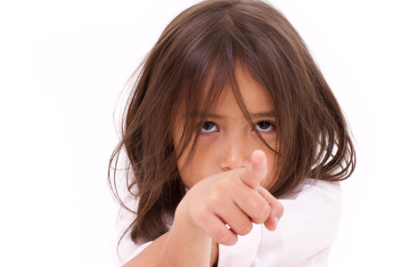 bored face: sad little girl, pointing at you Stock Photo
