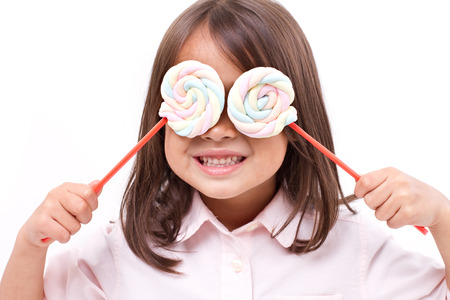 playful cute little girl posing with sweet pastel color marshmallow Stock Photo - 41430255