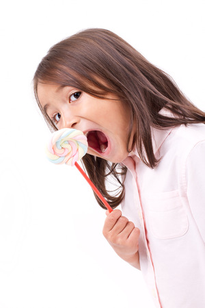 cute little girl eating marshmallow sweet candy Stock Photo - 41430262