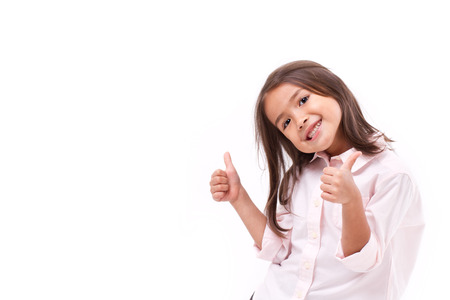 little girl child: kid giving two thumbs up Stock Photo