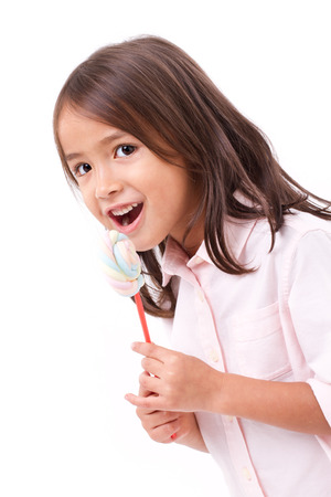 happy, smiling cute little girl eating marshmallow sweet candy Stock Photo