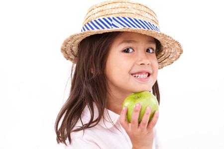 mignonne petite fille: Cute petite fille, la main tenant la pomme verte Banque d'images