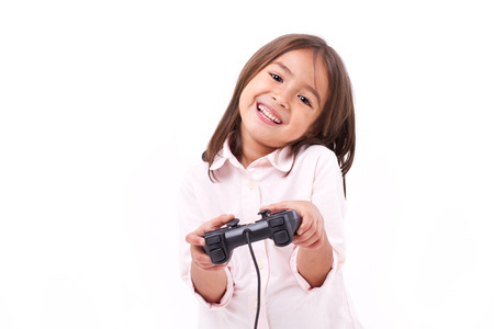 gamer: Happy little girl gamer playing video game Stock Photo