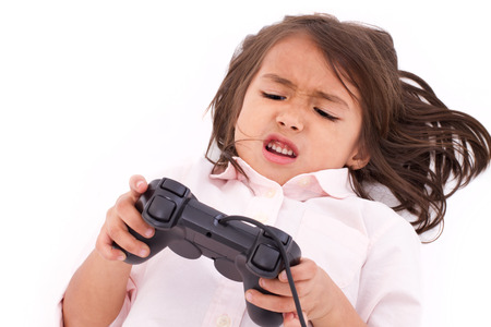 experiencing: Frustrated, upset, angry little girl gamer experiencing game over Stock Photo