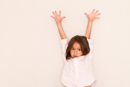 surrender: Happy little girl playing surrender
