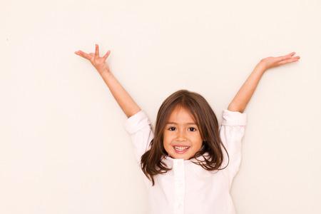 Succesvol, gelukkig meisje spelen Stockfoto