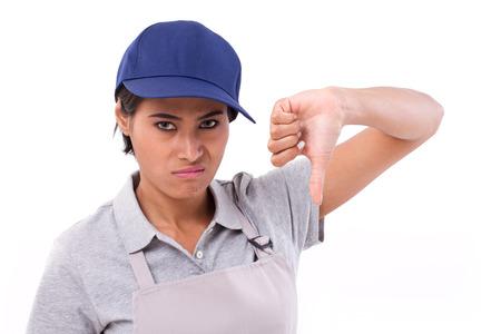 pulgar abajo: trabajadora infeliz que da el pulgar hacia abajo gesto