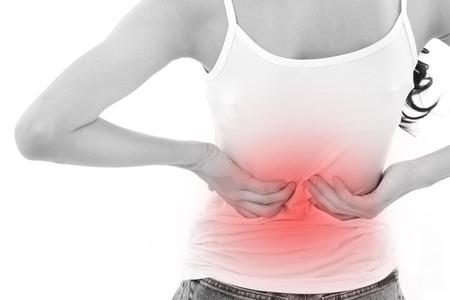 personas de espalda: mano de la mujer la celebraci�n de dolor o lesi�n en la espalda Foto de archivo