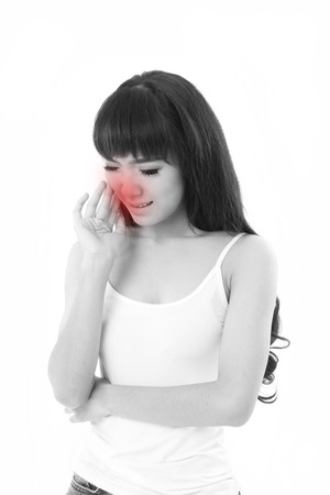 suffers: woman suffers from toothache or tooth sensitivity