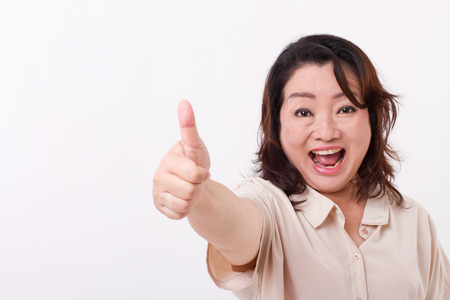 exited, happy, smiling, successful middle aged woman showing thumb up hand gesture Stock Photo - 43244022