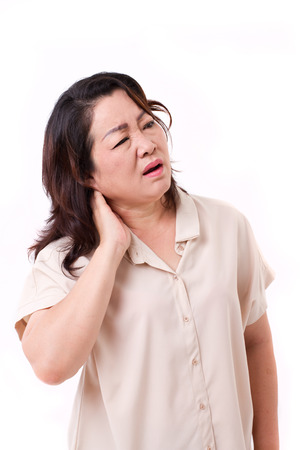 soreness: middle aged woman suffering from neck pain Stock Photo