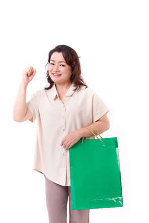middle age women: tough, happy middle aged asian woman with shopping bag