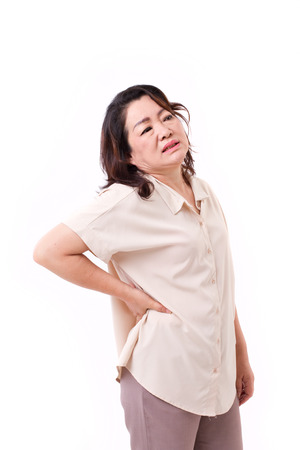 senior pain: middle aged woman suffering from neck pain Stock Photo