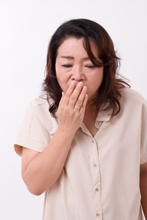 suffers: sick woman suffers from cold, flu, respiratory issue Stock Photo