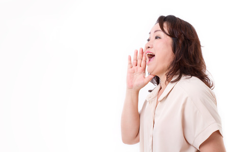 woman shouting: middle aged asian woman shouting, announcing, communicating Stock Photo