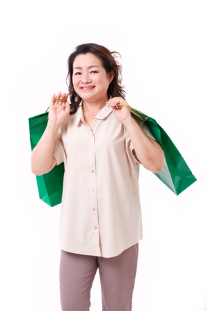 asian lady: happy middle aged asian woman with shopping bag