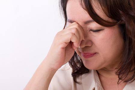 suffering: sick, stressed woman suffering from headache, migraine