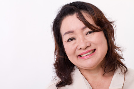 chubby woman: portrait of smiling, happy middle aged woman Stock Photo