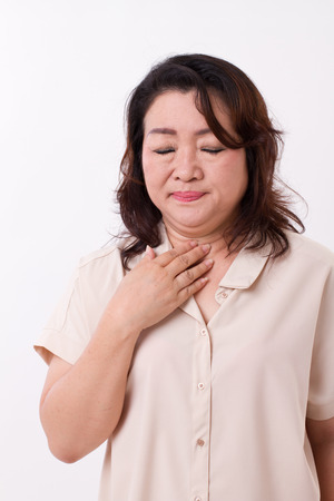 isolated woman: sick woman suffers from cold, flu, respiratory issue Stock Photo