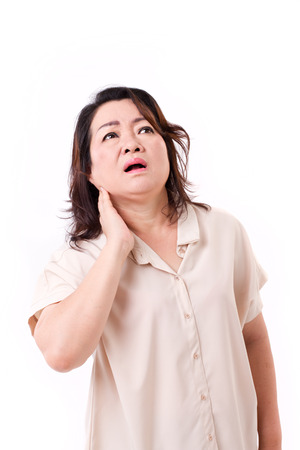 cramped: middle aged woman suffering from neck pain Stock Photo