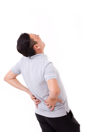 background person: man suffering from back pain, hand holding back Stock Photo