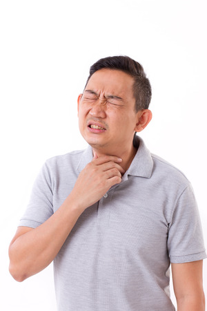 sick man suffering from sore throat Stock Photo