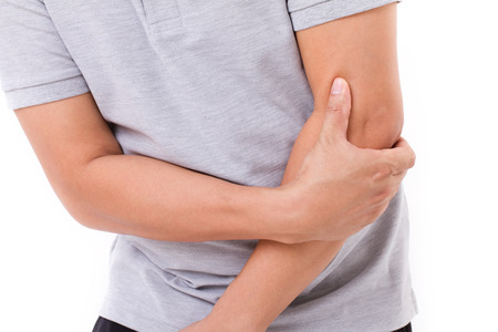 man suffering from elbow joint pain