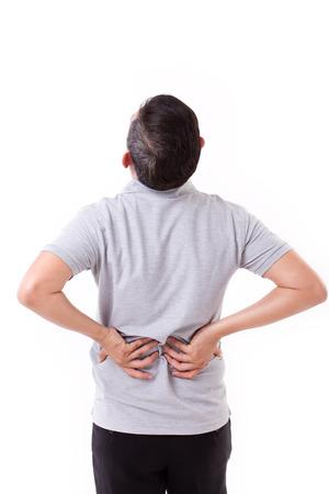 dolor espalda: hombre que sufre de dolor de espalda, la mano que sostiene la espalda Foto de archivo