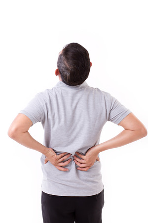 back pain: man suffering from back pain, hand holding back Stock Photo