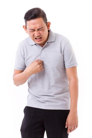 man die lijden aan zure reflux Stockfoto