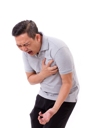 zieke man die lijden aan een hartaanval Stockfoto