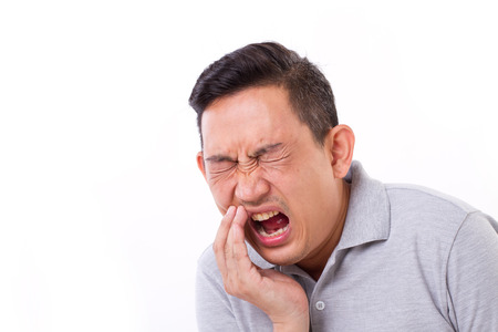 sensitivity: man suffering from toothache, tooth sensitivity