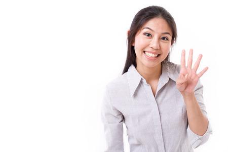 4 손가락 제스처를 보여주는 행복 한 여자 스톡 콘텐츠