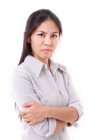 displeased: upset, displeased, irritated woman looking at you Stock Photo