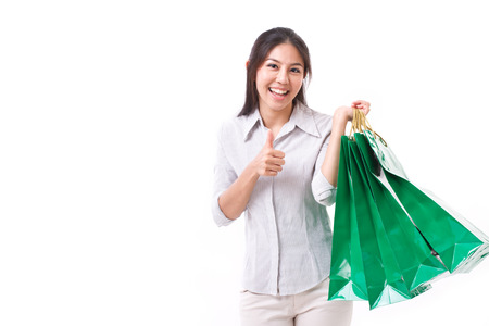 thumbup: shopping woman showing thumb up gesture