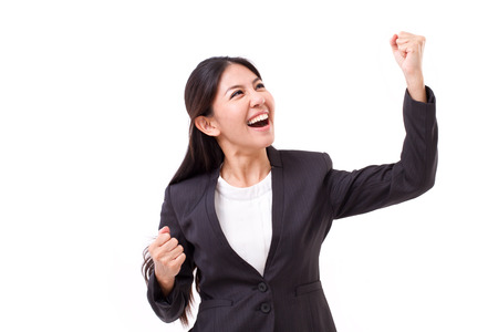 asian professional: exited, successful business woman looking up Stock Photo