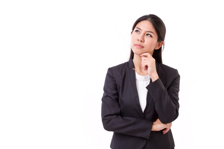 serious businesswoman thinking, looking up Stock Photo - 43848041