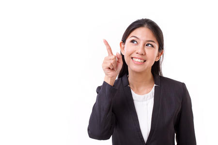 pointing finger up: thinking businesswoman executive with good idea