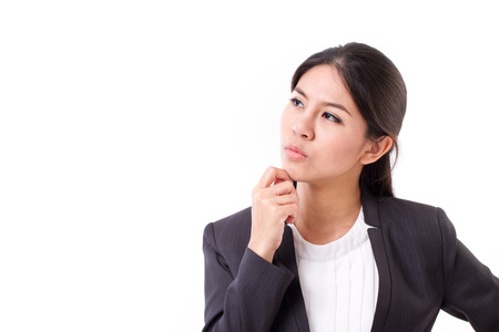 serious businesswoman thinking, looking up Stock Photo - 43848198